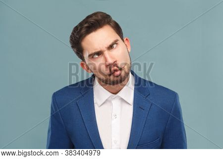 Closeup Portrait Of Man With Funny Stupid Mimicry Face