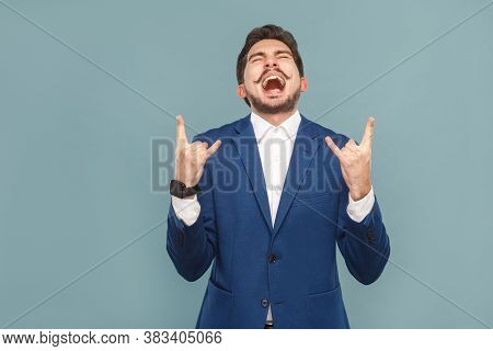Businessman Shout And Showing Rock And Roll Sign