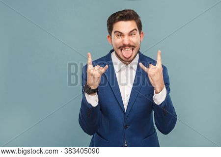 Aggressive Businessman Tongue Out And Showing Rock And Roll Sign