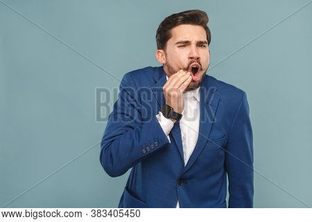 Well Dressed Man With Pain In Teeth