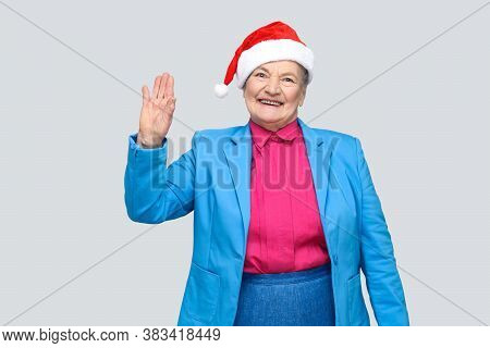 Hi, Nice To See You. Happy Toothy Smiling Colorful Casual Style Aged Woman With Blue Suit And Christ