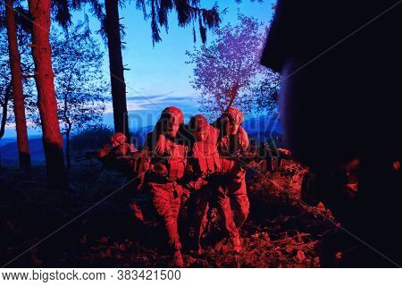 modern warfare military squad in battle action rescue wounded soldier  help and support concept