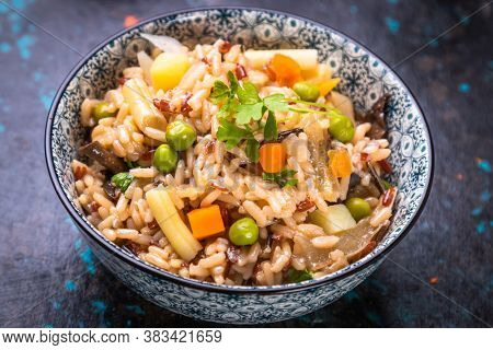 Risotto or cooked rice with mushrooms and vegetables