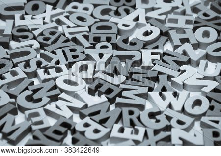 Abstract Black And White Background Of Wooden Letters Of The Latin Alphabet. Concept: Back To School