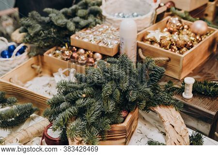 Creating A Christmas Wreath Of Spruce Branches And A Cardboard Frame. Craft Paper. Decoration For Th