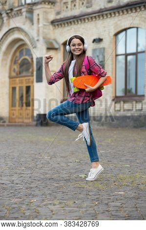Keep Going. Energetic Child Hold Penny Board Outdoors. Recreational Activity. Action Sport And Recre