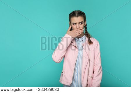 I'm Silent. Portrait Of Beautiful Cute Girl Standing With Makeup And Brown Pigtail Hairstyle In Stri