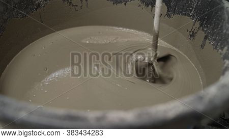 The Liquid Flooring Compound Is Mixed In A Bucket. The Mortar Is Mixed In A Bucket. Fresh Wet Mixed