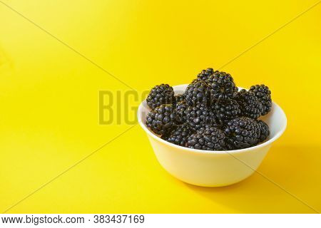 Dewberry. Blackberries In A Wooden Bowl On A Light Table. Fresh Blackberries In A Bowl Close-up. Spa
