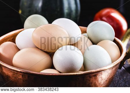 Colorful Caipira Egg Typical Of Brazil, In Copper Pot, On Rustic Wooden Background