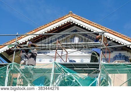 Georgetown, Penang/malaysia - Jan 03 2020: Worker Renovate Heritage Building Is World Unesco Heritag