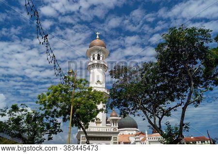 Georgetown, Penang/malaysia - Feb 14 2020: Masjid Kapitan Keling With Green Tree.