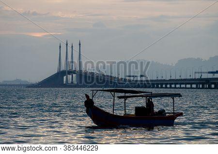 Georgetown, Penang/malaysia - Feb 15 2020: Fishing Boat At Penang Bridge.