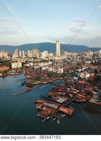 Georgetown, Penang/malaysia - Feb 28 2020: Aerial Clan Jetty Wooden House With Background Komtar Bui