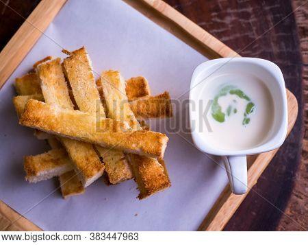 Slice Bread And Custard, On Wood Dish, Isolate.custard Bread.