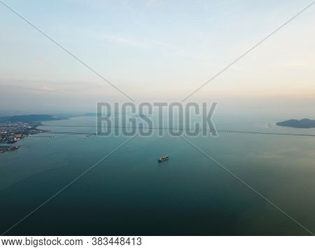 Georgetown, Penang/malaysia - Feb 28 2020: Ship At Penang Sea. Background Is Penang Bridge.