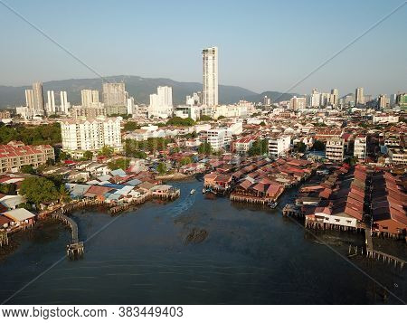 Georgetown, Penang/malaysia - Feb 29 2020: Drone Shot Clan Jetty With Background Komtar Building.