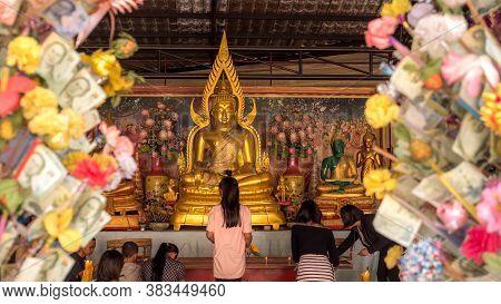 Pataya Thailand - January 14 - 2018:  [buddha Chinnarat]golden Buddhas Seated At Wat Phra Yai Temple