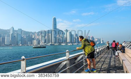 Hong Kong - December 10,2016:tourists Take Pictures And Enjoy The Famous Hong Kong Island Skyline Ac