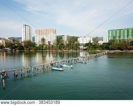 Georgetown, Penang/malaysia - Mar 17 2020: Wooden Bridge Jetty At Jelutong.