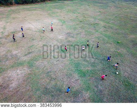 Malays Kids Have Fun Cycle, Play Football In Green Field.