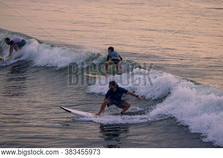 Kovalam, Tamilnadu- Indian, Oct 2, 2020. Foreign Tourists Floating On The Kovalam Beach In Chennai A
