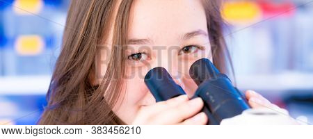 University nature science lab. Researcher working with binocular microscope