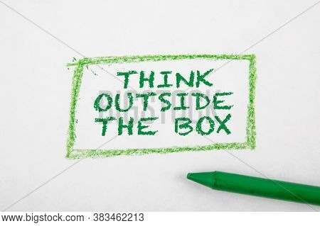 Think Outside The Box Concept. Text On A White Page