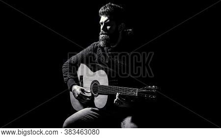 Bearded Guitarist Plays. Play The Guitar. Beard Hipster Man Sitting In A Pub. Guitars And Strings. B