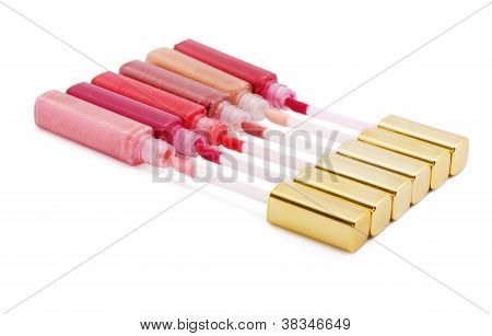 Set Of Coloured Lip Glosses Isolated On White