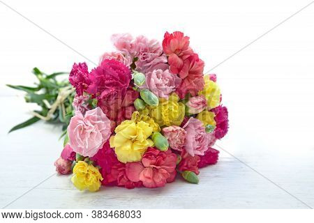 Beautiful Bouquet Of Colorful Flowers Carnation On A White Table