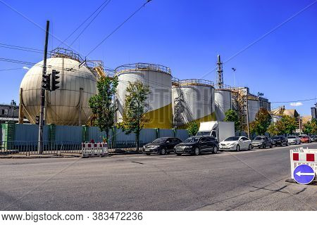 Dnipro, Ukraine - July 21, 2020: Huge Barrels, Tanks And Towers Of The  Dnipropetrovsk Oil Extractio