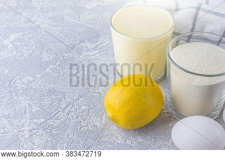 Cooking Lemon Pie Or Semolina Cake. Ingredients: Semolina, Sugar, Eggs, Lemon, Dairy. Homemade Food