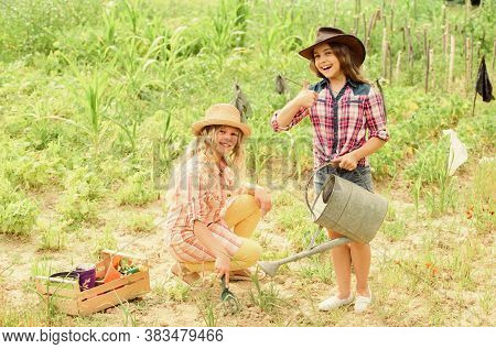 Rustic Children Working In Garden. Planting And Watering. Planting Vegetables. Hope For Nice Harvest