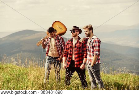 Feeling Free And Relaxed. Happy Men Friends With Guitar. Friendship. Hiking Adventure. Cowboy Men. W