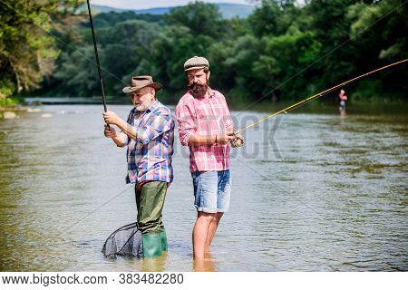 Male Friendship. Family Bonding. Two Happy Fisherman With Fishing Rod And Net. Hobby And Sport Activ