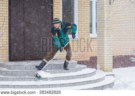 Winter, People And Problem Concept - Closeup Of Man Digging Snow With Shovel Near Yard. Man Standing