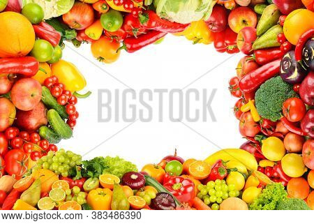 Rectangle frame of bright and colorful fruits, vegetables and berries isolated on white background.