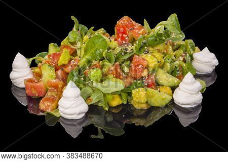Delicious Mixed Salad With Seeds, Spinach, Cucumbers And Tomatoes With Reflection, Isolated On Black