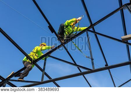 Safety Height Equipment In The Construction Site; Asian Worker Wear Safety Height Equipment To Insta