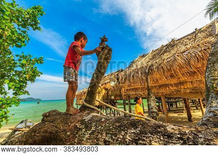 Surin Islands, Ko Phra Thong, Thailand - January 3, 2016: Little Boy Playing In Moken Village Of The