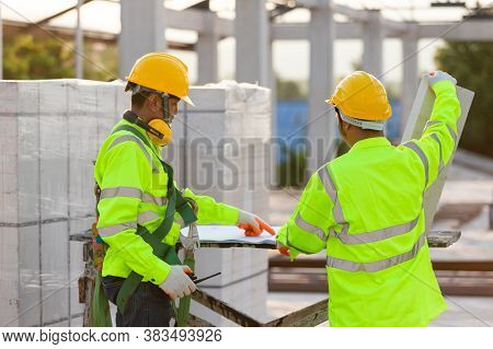 Asian Engineers And Workers Consulted Together For Construction Planning And Development, Concept Of