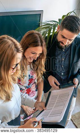 Business People Having An Informal Work Meeting Standing