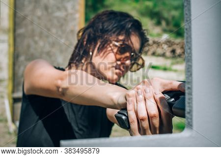 Close-up Abstract View Of Attractive Female Army Soldier With Gun