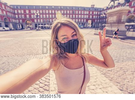 Attractive Happy Young Tourist Woman With Protective Face Mask Taking A Selfie In European City