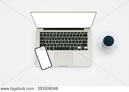 Laptop And Smartphone With White Blank Screen On Gray Background From Top View.