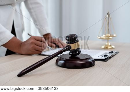 Professional Women Lawyers Work At A Law Office There Are Scales, Scales Of Justice, Judges Gavel, A