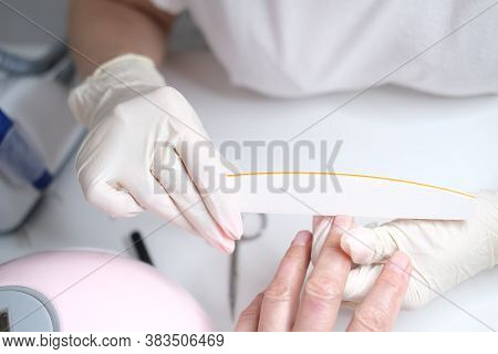 Professional Nail Care, Manicure Professional Nail Care, Manicure In A Beauty Salon. Hands Of A Mast