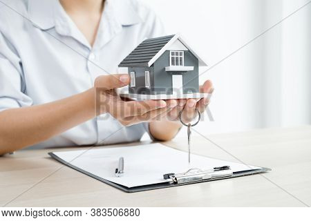 Real Estate Investment Agents Who Hold Keys With House Designs And Lease Documents, Make Home Purcha