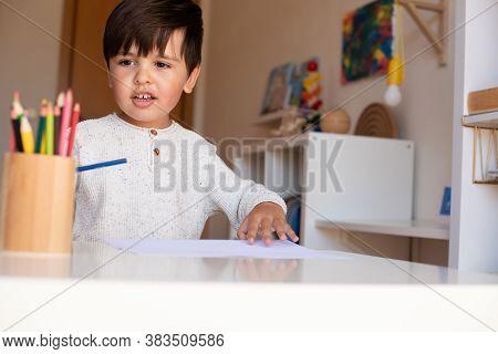 Preschooler Kid Drawing With Coloured Pencils. Homeschooling. Learning Community. Montessori School.